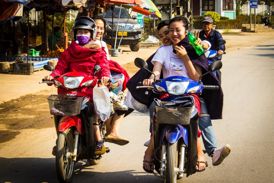 Cute Girls on scooters –  Laos
