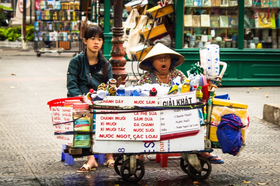Tired street vendors in Saigon